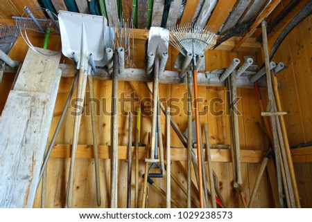Gardening Tools Hanging In Shed Detail