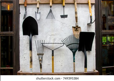 gardening tools on cement wall - tool concept.