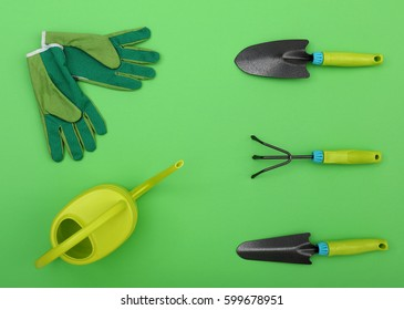gardening tools on a green background