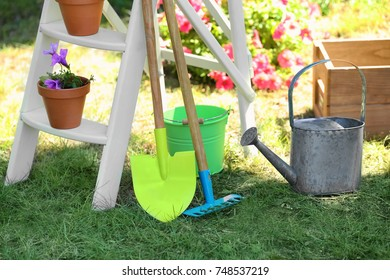 Gardening tools on green lawn