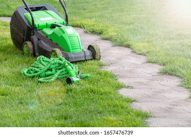 Gardening tools on a lush green meadow, garden manteinance, landscaping and hobby concept