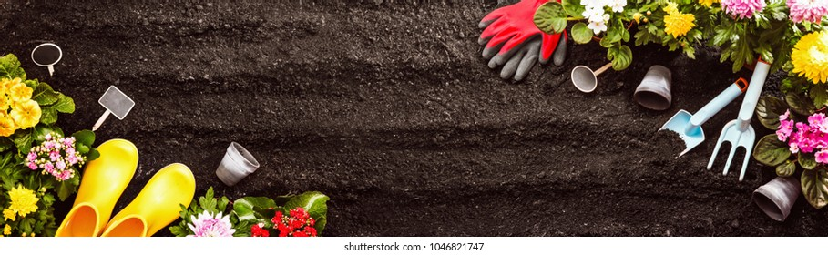 Gardening Tools on Soil Background. Spring Garden Works Concept - Shutterstock ID 1046821747