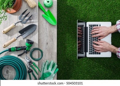Gardening tools on a table and gardener networking with a laptop, gardening and technology concept