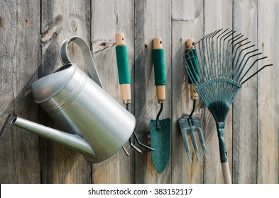 Gardening Tools on wood background