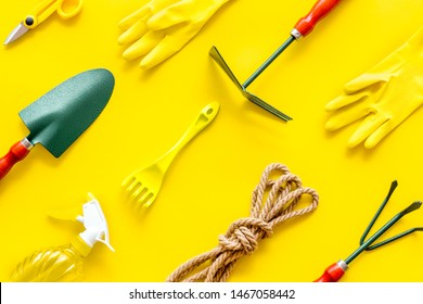 Gardening tools on yellow background top view pattern
