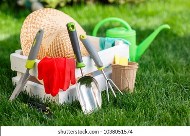 Gardening tools and utensils on green meadow, garden manteinance and hobby concept