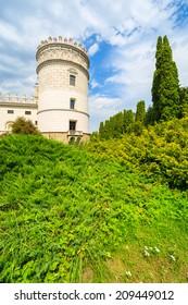 Gardens of beautiful Krasiczyn castle on sunny summer day, Poland