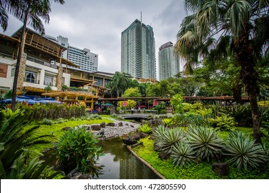 Gardens and skyscrapers at Greenbelt Park, in Ayala, Makati, Metro Manila, The Philippines.