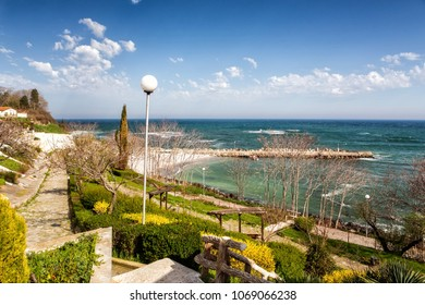 Gardent with flowers and old town panorama in Nessebar or Nesebar in Bulgaria, Black sea