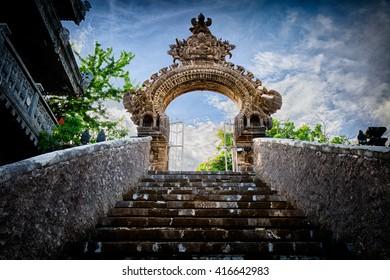 Gardian statue at entrance Bali temple / Bali Hindu temple / Bali, Indonesia