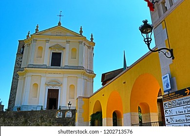 Gardone Riviera,Lombardy, Italy-July 19th 2018:Traditional Italian architecture and church at Via Vittorialе street Gardone Riviera town
