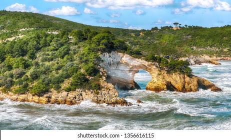 Gargano coast: San Felice arch (Architello). Vieste, San Felice arch rock bay, Gargano peninsula, Apulia, southern Italy, Europe.