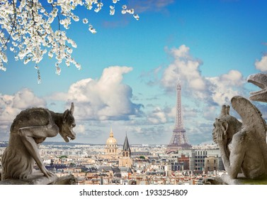 Gargoyle close up on Notre Dame Cathedral church in Paris and Parisian roof cityscape at spring, France