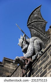 Gargoyle with Hand Extended Sits on Top of Wall at Eastern State Penitentiary Historic Site, Philadelphia, Pennsylvania