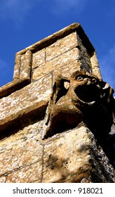Gargoyle on Church wall of St Giles, Chideock, Dorset, England