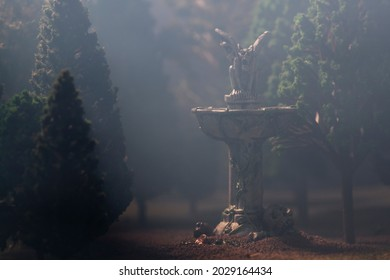 Gargoyle on fountain in forest at night