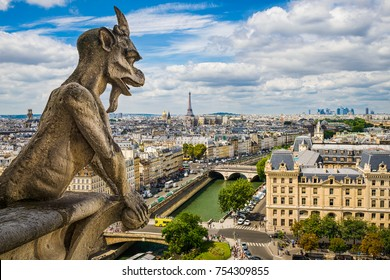 Gargoyle on Notre Dame with skyline of Paris and Eiffel tower, France