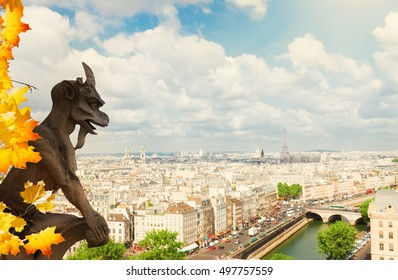 Gargoyle of Paris on Notre Dame Cathedral church and Paris cityscape with Eiffel Tower at fall day, France