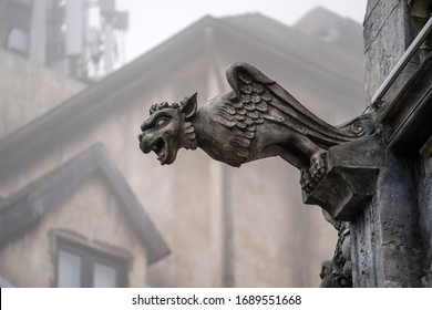 Gargoyle statue, chimeras, in the form of a medieval winged monster, from the royal castle in Bana hill, tourism site in Da Nang, Vietnam. Gothic old vintage gargoyle in a french village near Danang