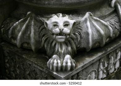 gargoyle statue on pillar