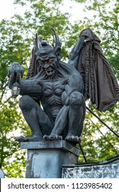 Gargoyle statue in the park. Stone sculpture
