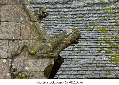 Gargoyle worn by the elements at Plougonven Parish close in Bretagne France
