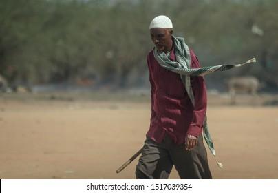 GARISSA, KENYA - AUGUST 13, 2019 - The Somali man walking in Dadaab Refugees Camp.