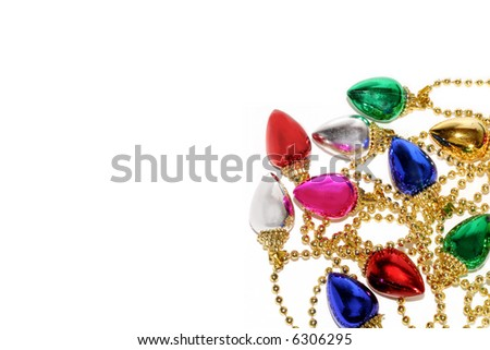 a garland of christmas lights on gold beads form corner border on white background