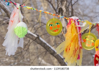 Garland decoration at the fair. Decorations of colorful pennants and colorful flag in the courtyard of the festival. Strings with flag