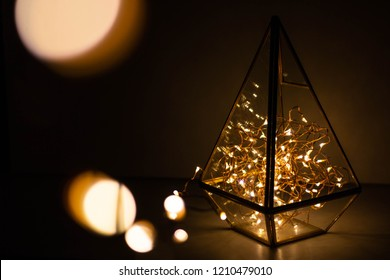 garland in a glass flask. candlestick garland in florarium glass geometric terrarium