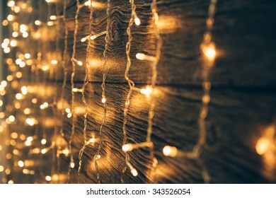 Garland Lights on old grunge wooden board. Christmas and New Year decoration.  Christmas lighting on wooden planks