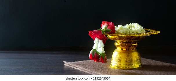 Garland for Mother Day of Thailand in the golden pedestal tray thai traditional on dark background /  Space for text and selective focus and adjustment size for banner, cover, header