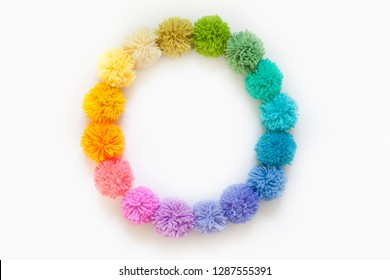 Garland and a wreath of colored pompons. Bright yarn pastel colors.