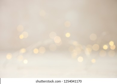 Garland with yellow lights on neutral background. Concept festive background. Copy space.