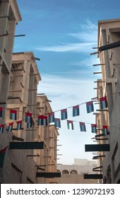 Garlands or small buntings of UAE flags displayed over old buildings in bur Dubai. UAE celebrates it's National Day on 2nd December every year.