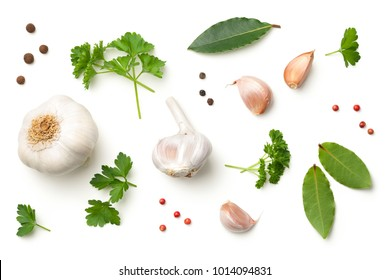 Garlic, bay leaves, parsley, allspice and pepper isolated on white background. Top view