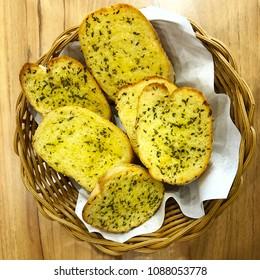 Garlic bread pieces in basket at restaurant