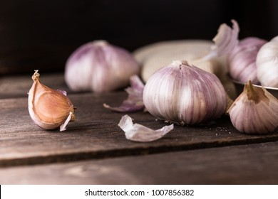 Garlic bulb  background on wooden table.