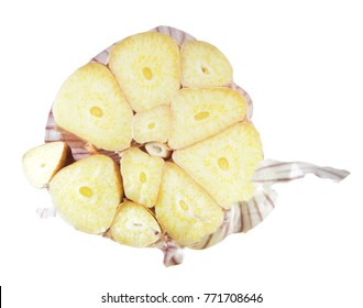 Garlic bulb cut in half inside cross section isolated on white background