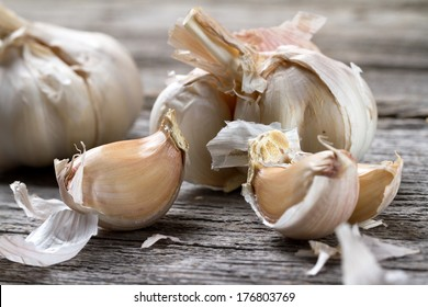 Garlic bulb on old wooden table