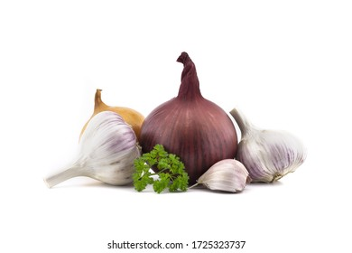 Garlic bulbs and cloves, green parsley twig, golden-brown and red onion isolated on white background
