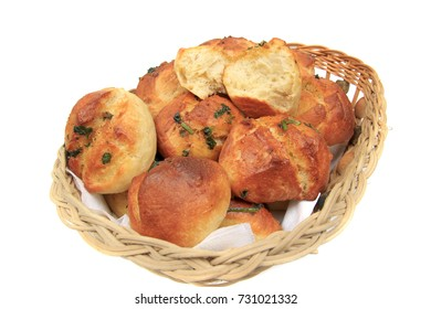 Garlic buns from the oven extracted and anointed with olive oil, garlic, parsley and spices