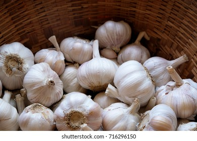garlic clove or garlic bulb in wicker basket