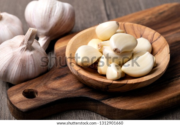 Garlic Cloves and Bulb in vintage wooden bowl