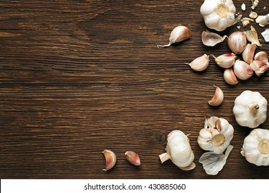 Garlic cloves on a vintage wooden background.