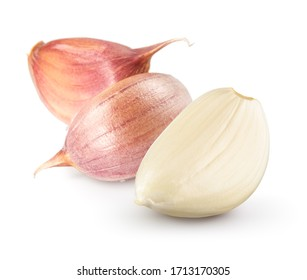 Garlic cloves on white. Garlic clove isolated. Peeled, unpeeled garlic cloves.