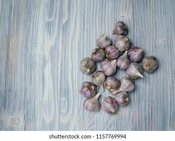 Garlic Cloves on a wooden table top