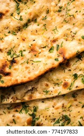 Garlic and coriander naan served in a plate, it's a type of Indian bread or roti flavoured with Lahsun