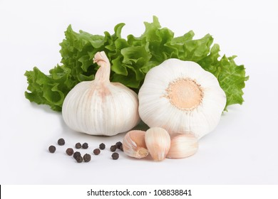 garlic decorated parsley leaves on white background