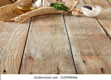 Garlic, Dill, Sour Cream and Olive Oil on a Beautiful Vintage Background. Fragrant Spices on Old Wooden Table and Burlap for Italian Recipe Template